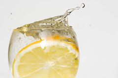 Lemon in water stock photo