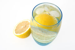 Lemon in water. Lemon in glass with mineral water and ice stock images