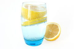 Lemon in water. Lemon in glass with mineral water and ice Stock Photos
