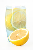 Lemon in water. Lemon in glass with mineral water and ice Stock Photography