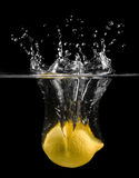 Lemon in water. Over black Stock Images