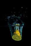 Lemon in water on black background Stock Photography