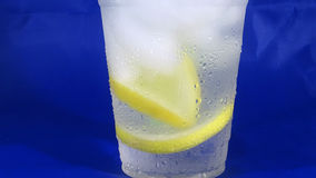 Lemon water. With a blue background royalty free stock images