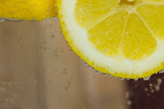 Lemon in water with bubbles Royalty Free Stock Images
