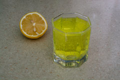Lemon And Water With Bubbles On The Countertop Stock Images