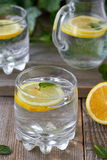 Lemon water. Cold lemon water with mint Stock Photos