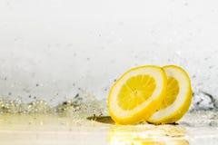 Lemon water drops. Fresh citrus yellow freshness Royalty Free Stock Photo