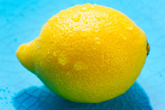 Lemon with water drops in the glass bowls Royalty Free Stock Images