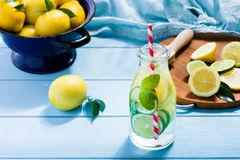 Lemon water in glass on wooden table royalty free stock photos
