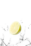 Lemon and water splash Stock Photography