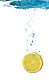 Lemon In Water Splash. Lemon is dropped into water splash isolated on white Royalty Free Stock Photos