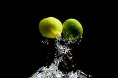 Lemon water Splash. 2 lemons falls deeply under water with a big splash Royalty Free Stock Images
