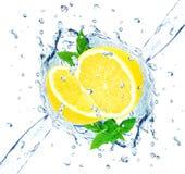 Lemon and water splash Stock Images