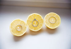 Lemon with wedding rings Stock Images