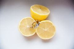 Lemon with wedding rings Stock Photography