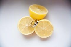 Lemon with wedding rings. The creative idea Stock Photography