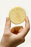 Lemon wedge Stock Photos