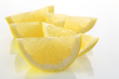Lemon Wedges Slices on White Plate. Lemon wedges, backlit on a white plate Royalty Free Stock Photos