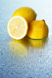 Lemon on wet surface Royalty Free Stock Photo