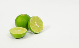 Lemon on white background. Lemon on a white background, and part of the cooking process to taste sour Royalty Free Stock Images