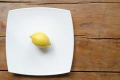 Lemon on the white dish Royalty Free Stock Image