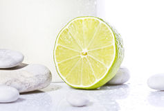 Lemon with white stones near Royalty Free Stock Photos