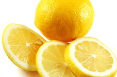Lemon whole and sliced. Isolated on white background with clipping path Royalty Free Stock Photos