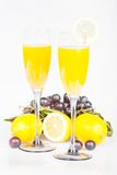 Lemon, wine glass with juice and grapes Royalty Free Stock Photo