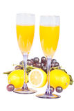 Lemon, wine glass with juice and grapes Royalty Free Stock Images