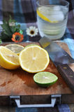 Lemon on wooden cutting board Stock Images