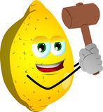 Lemon with a wooden hammer Royalty Free Stock Photos
