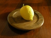 Lemon on wooden plate Stock Photography
