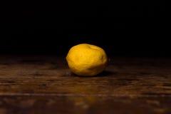 Lemon on wooden surface Stock Photos