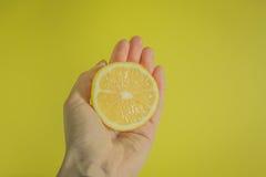 Lemon on yellow background Royalty Free Stock Image