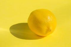 Lemon on yellow background Royalty Free Stock Photo