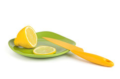 Lemon yellow and knife Royalty Free Stock Photography