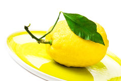 Lemon on yellow plate  on white Royalty Free Stock Images