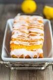 Lemon yogurt loaf cake, sliced on plate Stock Images