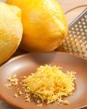 Lemon zest. Lemon ingeredient zest on brown plate royalty free stock images