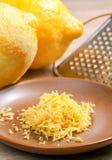 Lemon zest. Lemon ingeredient zest on brown plate stock images