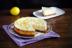 Lemon and zest cheesecake with cookie crumble and cream Stock Photos