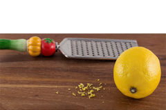 Lemon with zest and grater Royalty Free Stock Image