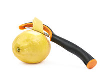 Lemon with a zest slicer knife. Lemon fruit with a zest slicer knife, composition isolated over the white background Stock Image