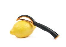 Lemon with a zest slicer knife. Lemon fruit with a zest slicer knife, composition isolated over the white background Royalty Free Stock Images