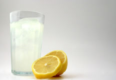Lemonade. Glass of fresh lemonade with lemon pieces Royalty Free Stock Photography
