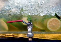 Lemonade. Ice lemonade in a tank with a tap royalty free stock photography
