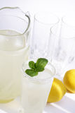 Lemonade. Pitcher of thirst quenching lemonade ready for the restaurant terrace or backyard barbeque royalty free stock images