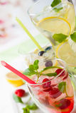 Lemonade with berries and fruits Stock Images