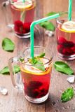 Lemonade of berries with lemon and peppermint. Summer drink presentation Stock Photo