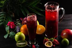 Lemonade blueberry - blackberry in a jug and a glass and fruit stock images